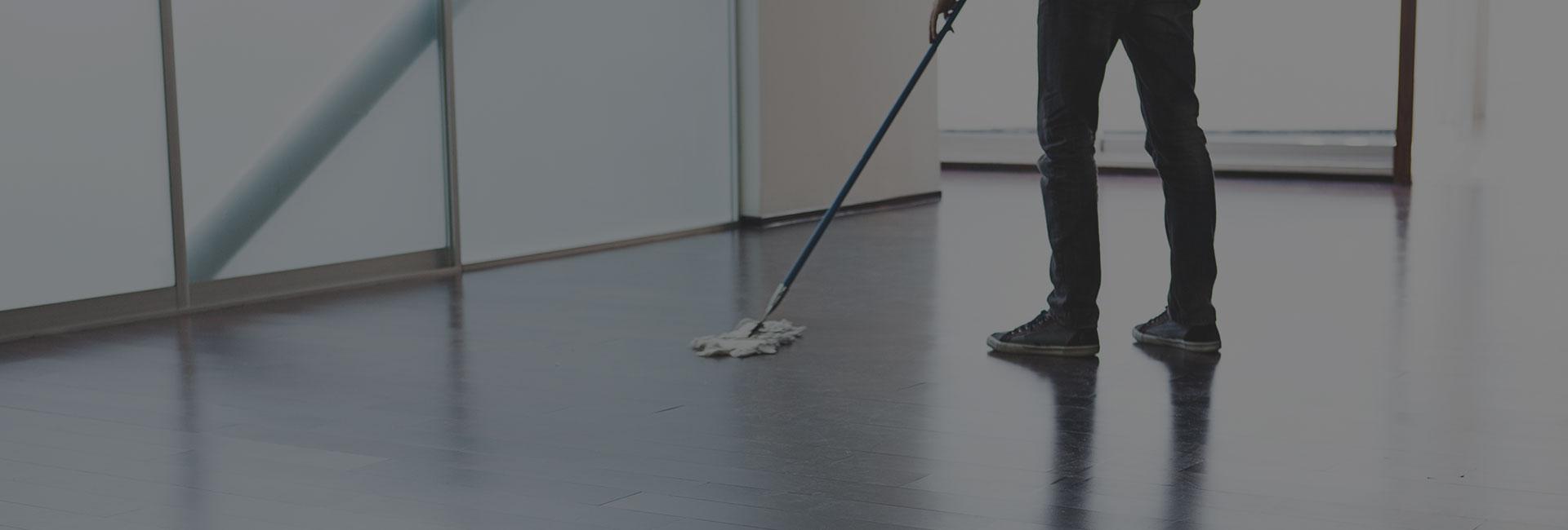 Porter Cleaning Hardwood Floors